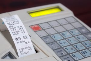 Cash register with cash register receipt